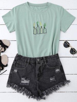 T-shirt à broderies végétaux